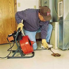 How to use a power auger to clear a floor drain. | Photo: Merle Henkenius | thisoldhouse.com