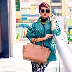 Nilu from Big Hair Loud Mouth looks like royalty in a combination of emerald green and tan. | 16 Indian Fashion Bloggers That Are Slaying This Tropical Winter