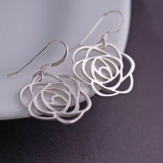 1 inch sterling silver rose flowers are hanging from sterling silver ear wires. They measure approximately 1 1/2 inches in total length. All jewelry will be gift wrapped. Let me know if you have any q