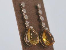 Wit gouden oorhangers met citrien en diamanten
