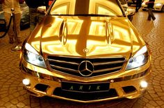 Golden Mercedes? I don't know....a lot of poor people could be fed instead! Pretty...but ..... GAWDY