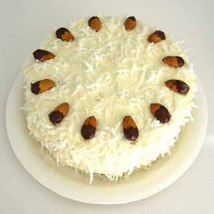 Almond Joy Cake (vegan): Chocolate cake with coconut frosting and chocolate dipped almonds Almond Joy Cake, Chocolate Almond Cake, Almond Cakes, Dark Chocolate Chips, Chocolate Dipped, Vegan Chocolate, Melting Chocolate, Buy Cake, Cake Shop