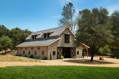 Grey toned party barn located in California. Sand Creek Post & Beam Barn Kits