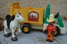What a cute Fisher Price Husky Helper Rodeo Rig Truck #330. This vintage cattle or horse rodeo truck/trailer comes with original white horse and cowboy--both are poseable figures with the horse having a built-in black saddle that the cowboy can ride. The back yellow part of the trailer lifts up and down to allow the horse to climb into the truck. The cowboys hat has a few bite marks but nothing too significant--overall condition is gently used! It is hard to find a complete set with lit...