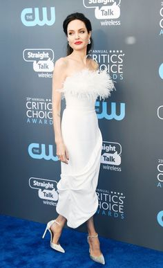 Angelina Jolie's award season looks this year all have one thing in common: feathers. At last night's Critics' Choice Awards, she wore a white strapless Ralph and Russo dress with feathers along the bodice just days after she wore a black Versace gown with dramatic feathered...
