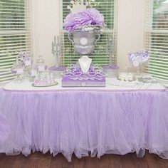 Love the idea of a table with tiaras, jewelry etc. would also double as the party favors! Add the rack on the side with the tutu's for each girl and we're all set!