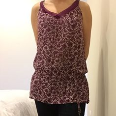 Pretty Purple Top This tank has a great purple/orchid color with a white pattern overlay. There is a tie a few inches from the bottom so you can adjust to fit however you please. It has been worn a couple of times, great with jeans, under a blazer, or with shorts! Forever 21 Tops Tank Tops
