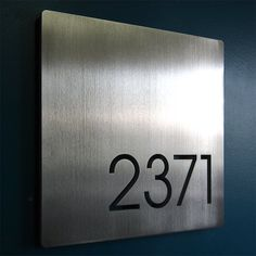 CUSTOM Minimalist Square House Number Sign in Aluminum  3/8 aluminum. For up to 5 numbers.  11.5 X 11.5  No visible hardware. Finishes in hand-brushed aluminum or swirly brushed aluminum or vertical brushed (in photo). All hardware and mounting instructions as well as a hole drilling template included.  Add your house number to the notes section of your order.  © 2017 Lucia Bennett