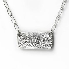 Textured Silver Bar Necklace - Horizontal Rectangle Necklace with Embossed Tree Branch and Leaves - Sterling Silver Bar Jewelry by LizardiJewelry on Etsy https://www.etsy.com/listing/528767577/textured-silver-bar-necklace-horizontal
