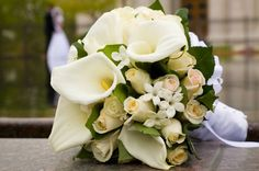 A Bouquet With Elegant Cala Lillies and White Roses Form This Gorgeous Wedding Bouquet//Bridebook//Wedding Flowers//Inspiration