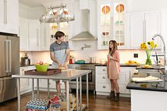 The stainless-steel appliances and center worktables give the vintage home's kitchen an updated look. New southern yellow pine floors resemble the longleaf pine originals that the owners reluctantly scrapped.