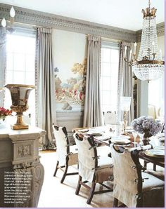 de gournay mural, slipcovered chairs, seagrass rug, crystal chandelier - all very nice
