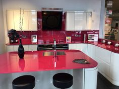 When coloured and bright glass enhances the beauty of a kitchen...DecoGlaze splashback and 19mm worktop displayed in Magnet Guildford Showroom.