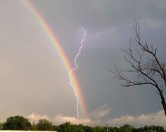 A double rainbow with a bolt of lightning striking through the centre was captured yesterday in an extraordinary freak weather display.    The rare image was captured in Hamilton, Ohio as thunderstorms battered the midwest region, causing thousands of dollars worth of damage.  Read more: http://www.dailymail.co.uk/news/article-2138697/Lightning-bolt-double-rainbow-Ohio.html