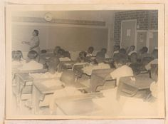 Photograph of African American elementary school students observing their teacher in a classroom in Sylvania, Georgia, 1951. Screven-Jenkins Regional Library System.