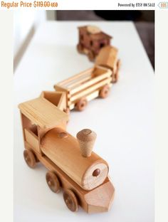 Woodworking Training Handcrafted Wooden Toy Train Set by delcraftSF Woodworking School, Woodworking Toys, Woodworking Magazine, Woodworking Furniture, Wooden Toy Train, Wooden Toy Plans, Making Wooden Toys, Wooden Pegs, Wood Toys