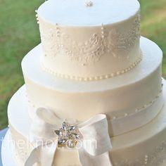Precious belt bow around the cake @Gwen  Miller @Kendra Barnes