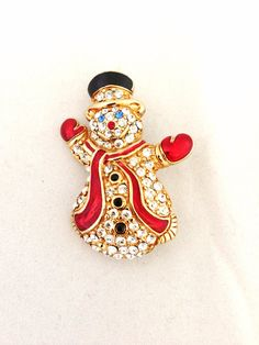 Rhinestone Snowman Holiday Brooch - red scarf & blue eyes signed Monet- xmas - Christmas - merry -red, black, blue - mittens - top hat on Etsy, $20.00