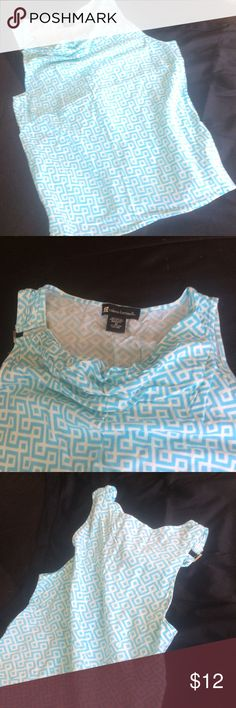 Blue and white printed dressy tank Soft blue and white geometric pattern dressy tank with silver rectangle accent on right sleeve and scoop neck. 💯 rayon Excellent condition! No signs of wear, snags or stains. Bundle for further discounts! Valerie Bertinelli Tops Tank Tops
