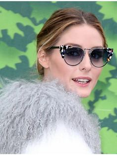 Who made  Olivia Palermo's cat sunglasses, red handbag, white sneakers, and gray coat?