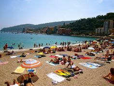 The best beaches in Nice, via C'est Christine. Pictured: Villefranche beach plage on a Saturday in the French Riviera, France