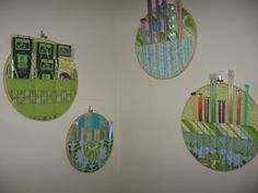 Wall-mounted embroidery hoops with knitting needle pockets