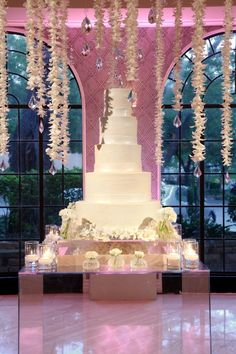 Draping florals over a towering five tiered cake...