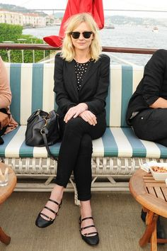 triple-strap mary janes, black blazer with a poka dot shirt and black skinnies with her classic black ray bans, classy look.