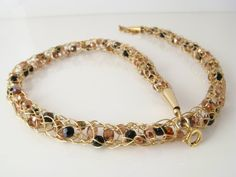 Gold wire crochet necklace amber crystals