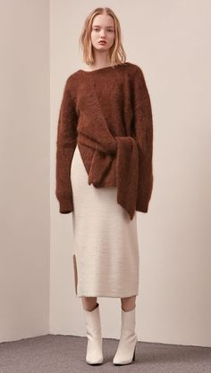 The Amuza Sweater in dark brown. Features chunky knit wrap-style sweater in dark brown alpaca and angora blend. Long sleeves, V-neckline (can be styled backward), self-tie wraps front around the waist