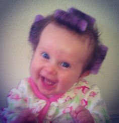My little stinker! 3 months old with curlers in her hair.  Funny baby