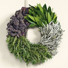"Cooks Herb Wreath    Cooks will delight in this fragrant wreath made solely of culinary herbs that can be used in cooking: bay leaf, sage, rosemary and oregano. The herbs are shipped fresh and will remain useful as they dry. The wreaths are bound without glue so the herbs can safely be used in your recipes. Protect from weather. 14"" diam."