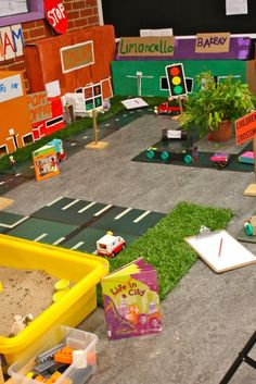 """City provocation in the construction play area Cut up Ikea """"grass"""" rug for the block area and small world setups? Play Spaces, Learning Spaces, Learning Environments, Learning Centers, Inquiry Based Learning, Early Learning, Block Area, Block Center, Just Kids"""