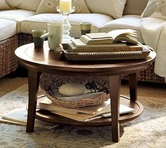 Metropolitan Round Coffee Table #potterybarn  I think I will be purchasing this!!  @Cortney Guilford   @Lindsey Schwab Kimery  what do you ladies think? They have a darker color I think I would get.