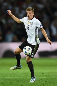 Germany's midfielder Toni Kroos controls the ball during the Euro 2016 group C football match between Germany and Ukraine at the Stade Pierre Mauroy in Villeneuve-d'Ascq near Lille on June / AFP / PATRIK STOLLARZ Football Match, Football Players, Uefa Euro 2016, Toni Kroos, Real Madrid, Ukraine, Squad, Germany, June