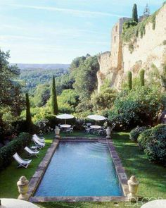 Inspired by an ancient fortress on a dramatic cliffside property in Provence's Luberon region, French decorator Michel Biehn installed a rustic, stone-edged pool embellished with ornamental urns at each corner. I'm absolutely in love with this pool! Oh The Places You'll Go, Places To Travel, Places To Visit, Outdoor Spaces, Outdoor Living, Belle France, Life Design, Cool Pools, Epic Pools