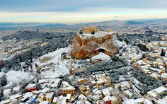 A rare sight of Acropolis covered in snow caused by the recent European cold wave Athens Greece [OS] [960600]
