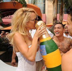 Pam Anderson loves her champagne cake!  www.gimmesomesugarLV.com