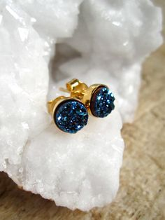 Glittering bright blue druzy quartz coins are bezel set in shiny, polished gold vermeil ear posts with backs. Natural, druzy stones are vapor coated with titanium to bring out a brilliant, consistent blue color. Each stud is 6 mm round. 18K gold vermeil bezel setting is polished to a high shine for a beautiful contrast in tone and texture. They are nickel free and suitable for sensitive ears. A wonderfully sparkly alternative to classic studs. You will want to wear them all the time! Also…