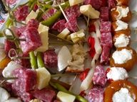 things on skewers! great ideas for party food/appetizers and summer BBQs. Salami, cheese, peppers, etc.