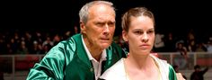 """Clint Eastwood, Best Director and a producer of  the Best Picture winner """"Million Dollar Baby,"""" with Best Actress winner Hilary  Swank in a scene from the movie. Great father & daughter movie."""