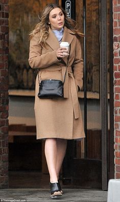 Stepping out: Elizabeth Olsen went solo as she stepped out in NYC on Tuesday...