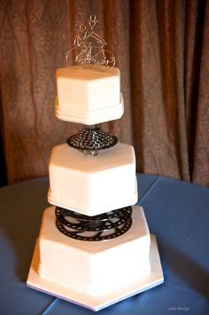 A bike enthusiasts wedding cake with actual bike gears
