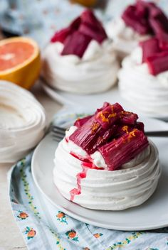 Sweet and tangy rhubarb nests in pillowy meringue clouds for a light and luscious spring dessert.