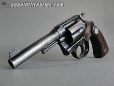 "Colt Police Positive .38 Special Circa 1943 with 4"" barrel, 6-shot cylinder capacity, factory leather holster, and genuine Colt wood stocks with medallion."