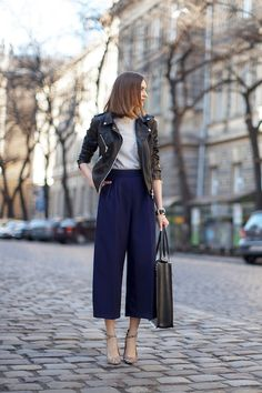 leather moto jacket, grey tee, high-waisted blue pants and ankle strap floral print heels #style #fashion #office #work