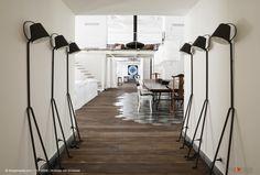 Retro, black standard lamps against walls in corridor of loft apartment | © living4media | Andreas von Einsiedel | 11216668
