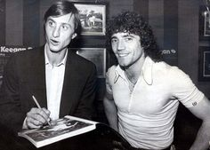 Kevin Keegan (right) poses with Cruyff at a book launch in Los Angeles in 1979