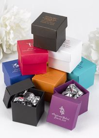 """Treat your guests to a favor nestled in these gift-box style boxes. The 2"""" x 2"""" x 2"""" boxes come in a variety of colors! Each color is sold in a package of 25 that includes both the lid and base (50 pieces total). Favor box is personalized with a design of your choice and two lines of personalization in your choice of foil color. For example, bride and groom's names on one line and wedding date on second line. Personalization will allow for up to 20 characters per line including spaces…"""