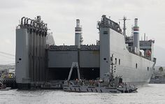 Sailors attached to Amphibious Construction Battalion (ACB) 1, on the improved Navy lighterage system (INLS) Warping Tug 2 back out from the elevator of the Military Sealift Command heavy lift ship SS Cape Mohican (T-AKR 5065) after positioning two INLS combination modules during Exercise Brilliant Zenith 2015 (BZ15).